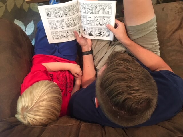 Husband reading aloud to kid